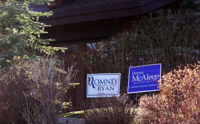 Signs supporting Republican Mitt Romney and Democratic congressional candidate Donna McAleer decorate the Solamere property of Larry Grabarnick. McAleer hopes there are many others who will vote for her even as they cast their presidential ballot for Romney. Tyler Cobb/Park Record