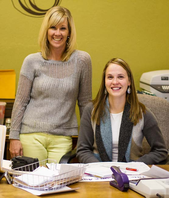 Morgan Carlson (right), a MLC Insurance agent, and Brandie Cole, office manager, have been putting a  new-school  spin on insurance at the company since 2010.