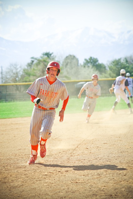 Blake Morin and TJ Mayo round the bases in Park City's 9-2 win over Skyline on Friday.