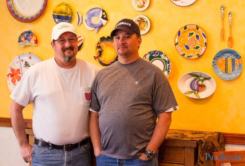 Chez Betty co-owner, Tom Bell, and chef Jerry Garcia display plates that have been donated by regular customers to the restaurant from across the world, including France, Tunisia, Turkey, Peru, and many more. After more than 20 years in service, the locally acclaimed Chez Betty restaurant will be shutting its doors. (Photo by: Christopher Reeves)