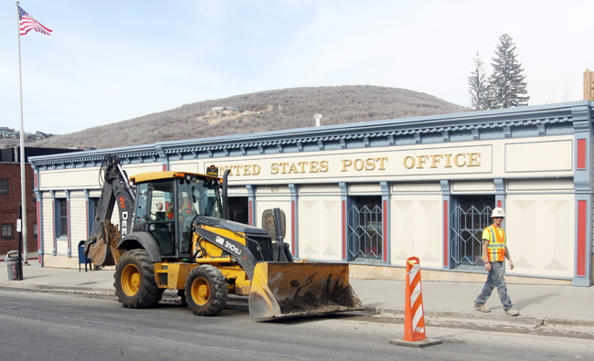 Equipment has arrived along Main Street as a major improvement project starts. Some of the work will include the construction of new stretches of sidewalk and redoing the walkway outside Café Terigo. Tyler Cobb/Park Record