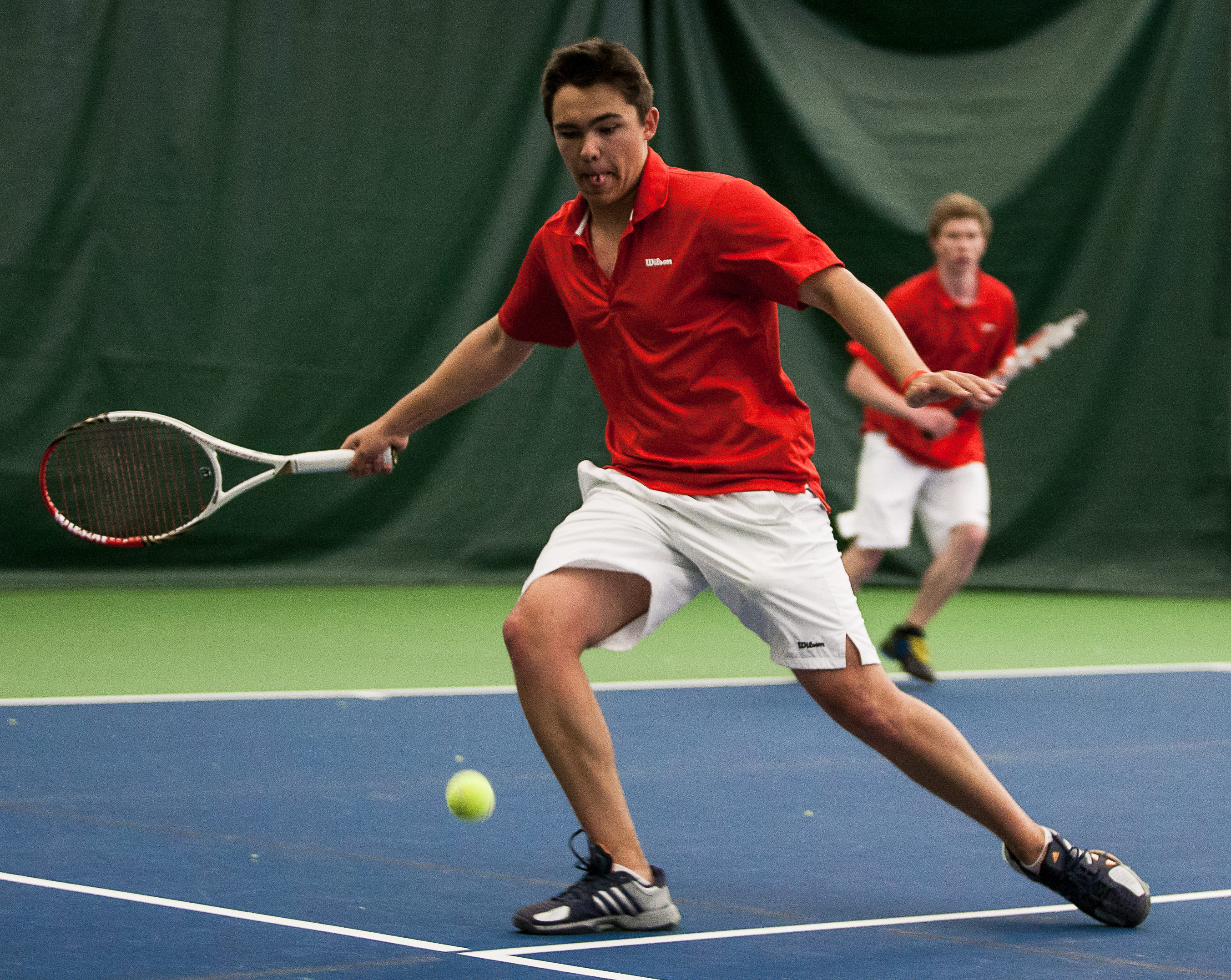 Zach Johnson returns a Judge Memorial shot as No. 1 doubles partner Graham Petersen looks on. The Park City High School tennis team hosted Judge Memorial at the PC MARC on Monday afternoon, winning the match 3-2. Christopher Reeves/The Park Record