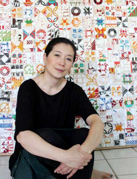 "Visual artist Kaori Takamura sits in front of one selection from her ""American Quilt"" series. Takamura will be in Park City on June 28 for an artist reception at the Meyer Gallery. (Photo courtesy of the Meyer Gallery)"