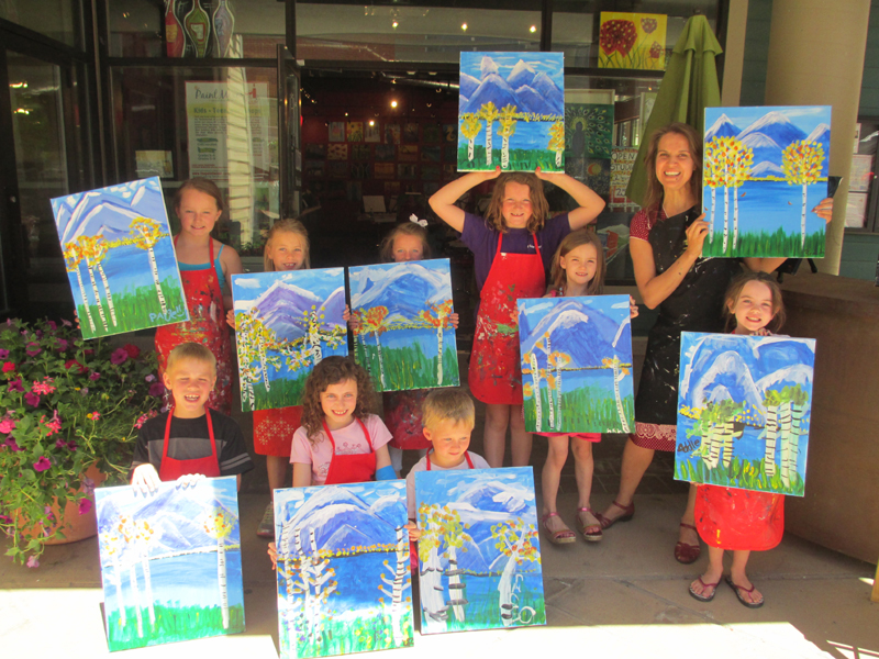 Young artists in grades kindergarten through four show their paintings they created during the Paint Mixer's inaugural summer camp that was held June 17 through June 20. The group, led by Anne-Marie Buckland and Brenda Hotteye, displayed their works in a session-ending exhibit. (Photo courtesy of The Paint Mixer)