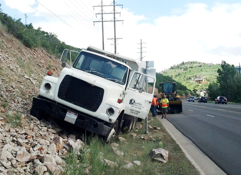 A truck came to rest on an embankment along Deer Valley Drive on Friday after the brakes failed as it descended Marsac Avenue. The driver, the only person inside, was not injured. Courtesy of the Park City Police Department