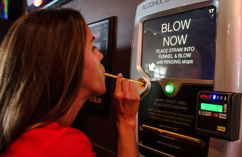 Breathe Legal CFO Joanna Fankhauser demonstrates how patrons use Breathe Legal s breathalyzer machines that are being installed across the United States. (Christopher Reeves/The Park Record)