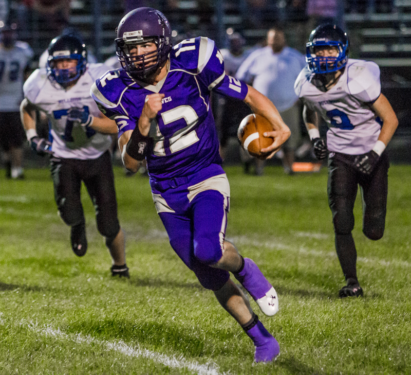Ryan McMichael carries the ball during last week s win against Gunnison. McMichael scored three times during Friday night s road win at Summit Academy. Christopher Reeves/The Park Record