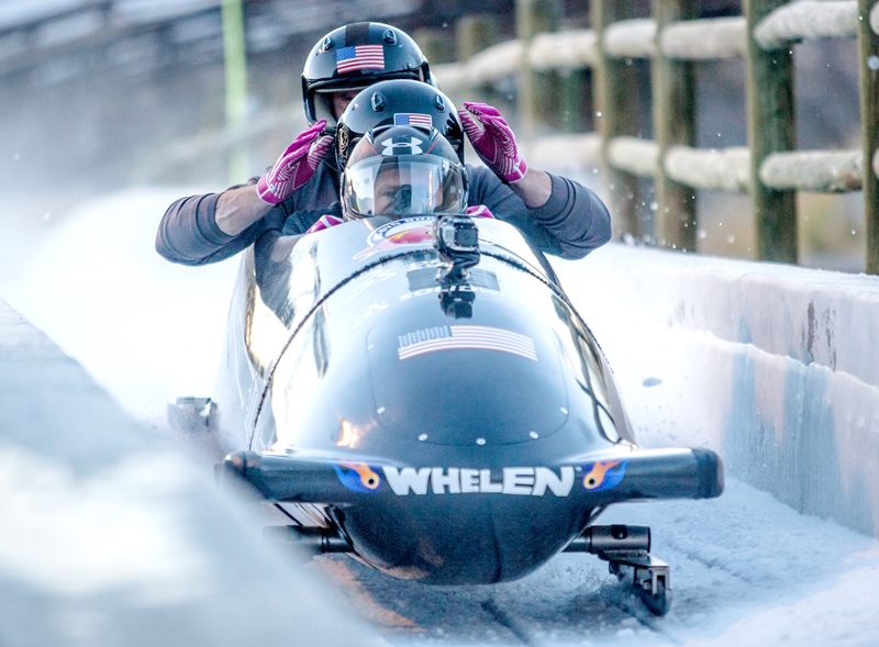 From front to back, Steven Holcomb, Curt Tomasevicz, Steve Langton and Chris Fogt arrive at the finish line of the bobsled track Wednesday at the UOP.