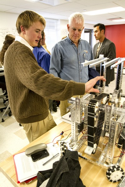 Park City High School mechanical engineering student Nicolas Miller, left, explains the functions of a robot built for the First Tech Challenge Competition to Summit County Chair Representative Glenn Wright on Tuesday, Nov. 12, during the Park City Center for Advanced Professional Studies (PC CAPS) Grand Opening. Christopher Reeves/Park Record.