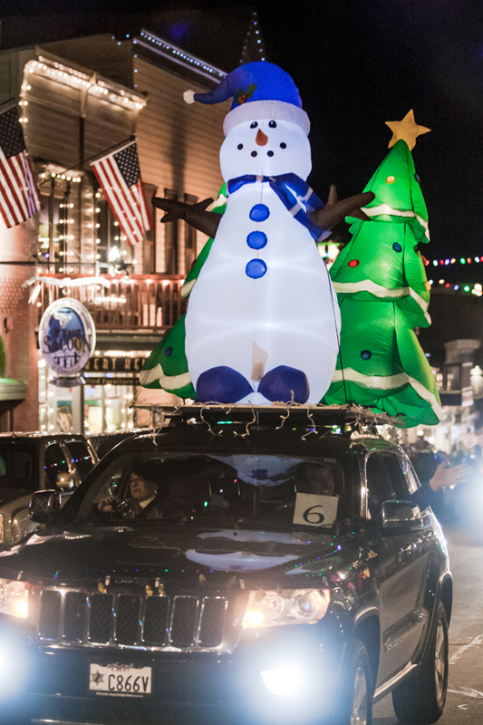 An inflatable and illuminated snowman and Christmas tree don one of the entries in Historic Park City Alliance's annual Electric Parade last week. (Christopher Reeves/Park Record)