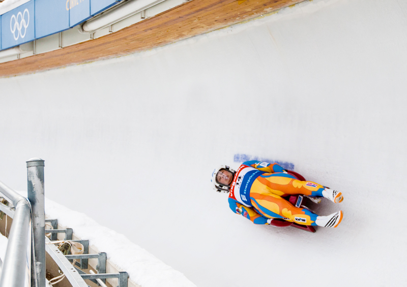 Matt Mortensen, #14, and teammate Preston Griffall slide around a turn at the Utah Olympic Park on Friday afternoon. Christopher Reeves/The Park Record