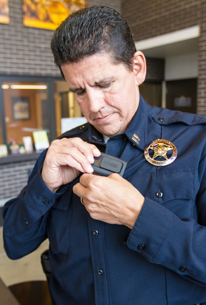 Phil Kirk, a Park City Police Department captain, attaches one of the new body cameras that the department recently purchased with state and federal grants. The body cameras are used in a wide range of situations. Christopher Reeves/Park Record