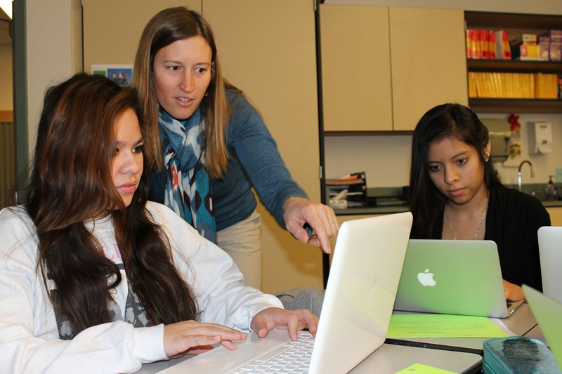 Treasure Mountain Junior High School ninth-grader Victoria Trejo, left, receives assistance from her Heritage Language class teacher, Laura Bechdel, while classmate, Park City High School junior Ana Reyes, right, concentrates on classwork on Tuesday, Jan. 7, at Treasure Mountain Junior High School. Alexandria Gonzalez/Park Record.