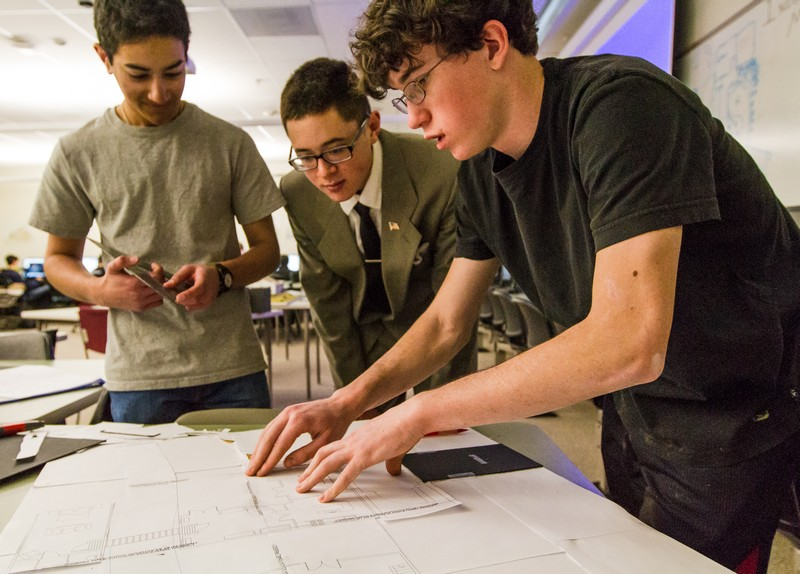Park City High School students Omar Hussain, left, Victor Liwanag, center, and Riley Broussard work together on Monday, Jan. 27, to build a 3-dimensional model home from a 2-dimensional architectural floor plan designed with AutoCAD software. Christopher Reeves/Park Record.