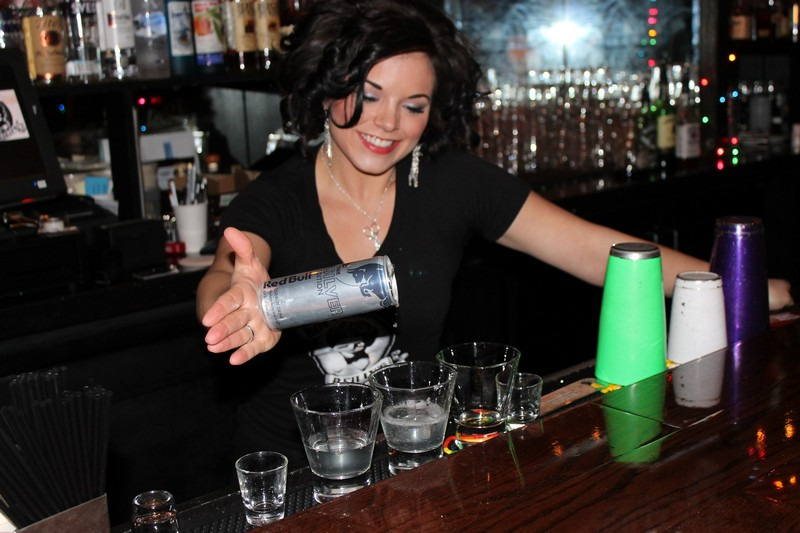 Flair bartender Erica Taylor pours an Irish Mule   Bushmill s, blackberry, Bundaberg ginger beer and a lime wedge   for several customer at Rock & Reilly s on Main Street on Thursday, Jan. 30. Alexandria Gonzalez/Park Record.