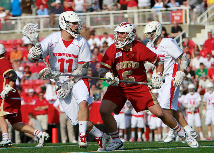 Nick Gradinger, right, fends off a Stony Brook player during his college days at University of Denver. Photo courtesy of University of Denver Athletics