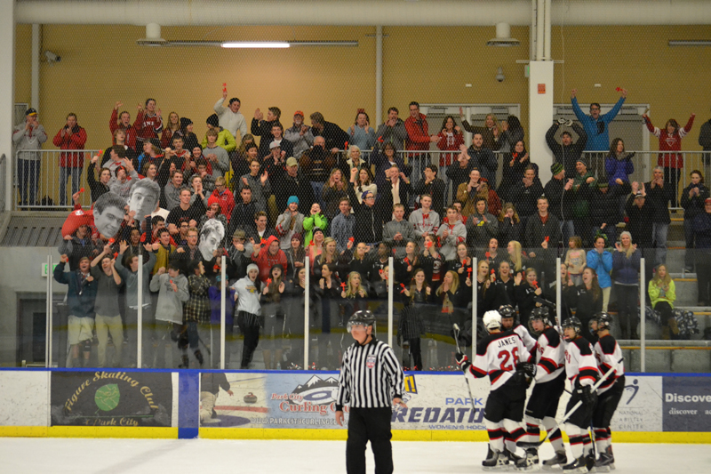 Complete with oversized Robbie Derber heads and noisemakers, the raucous crowd celebrates Carson Walker s second-period goal. Photo courtesy of Randy Hanskat