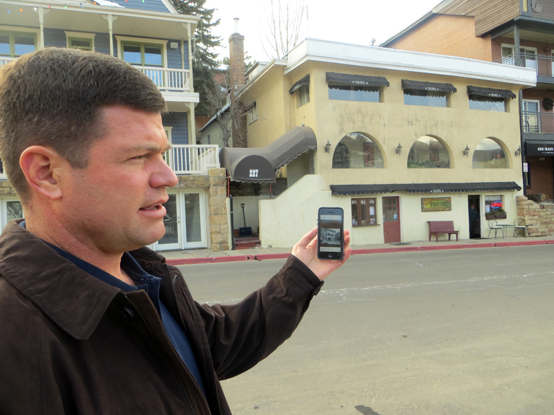 Todd Cusick, the manager of a firm that has acquired three Main Street properties, shows a historic photo of the Star Hotel on his smartphone during a Wednesday visit to the building, sitting across Main Street. His firm also acquired the Imperial Hotel, on the left. Jay Hamburger/Park Record