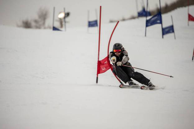 Will McDonald carves around a gate at Park City Mountain Resort during a Town Race Series giant slalom race. McDonald won the men s overall title. Photo courtesy of Ben Pieper