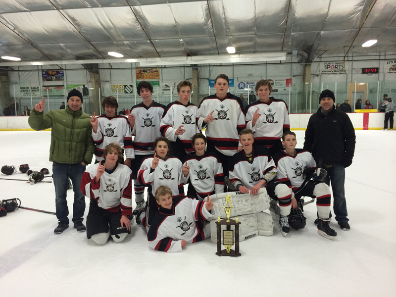 The Park City Ice Miners celebrate their tournament victory in Bozeman, Mont. Pictured from left to right, top row: coach Marc Colaizzi, Aidan Shaw, Clay Groves, Dylan Williams, Jordan Kee, Beau Pederson and coach Steve Shaw.  In the bottom row are: Teddy Elbert, Gabriel Rosa, Marc Colaizzi, Carter Kovar, Bobby Gallard and Andrew Pederson. Photo courtesy of Derek Elbert