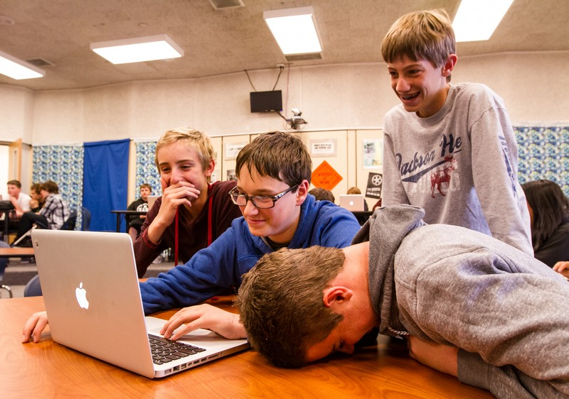 Mikal Peterson, far left, Lance Tallman, Zane Schemmer and Conner Christoffersen laugh while editing their group music video in their Filmmaking and Production Process class Monday, April 21, at Treasure Mountain Junior High. Christopher Reeves/Park Record.