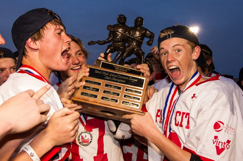 The Park City High School boys' lacrosse team celebrates after winning the Division I state championship on Saturday at Dozier Field. (Christopher Reeves/Park Record)