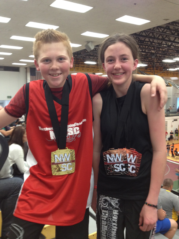 Ethan Erb, left, and Shea Fenton show off their medals at the Northwest Submission Challenge in Boise, Idaho. Photo courtesy of Ramona Stark