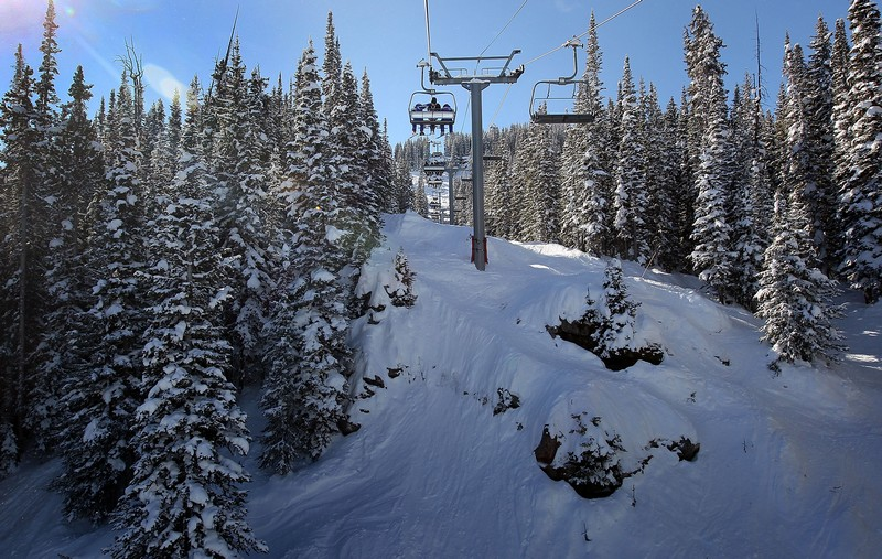 "A 'wounded warrior' rides up a Vail Mountain ski lift with two instructors in 2010. A Wall Street analyst sees the possibility of ""another Vail Mountain"" in Park City as a result of recent rulings in a lawsuit involving Park City Mountain Resort, Vail Resorts and Talisker Land Holdings, LLC. (John Moore/Getty Images)"