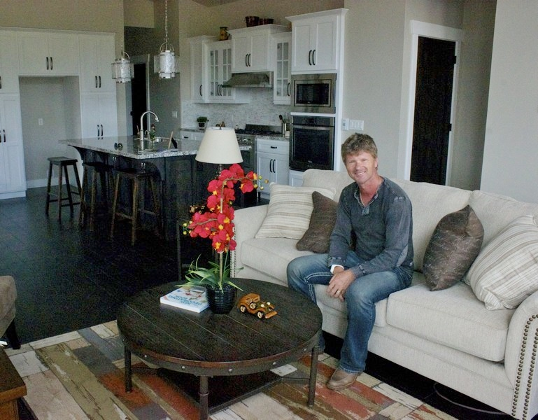 Ivan Pokusa sits in a home he recently staged in Midway, Utah. (Erin Carmichael/Park Record)