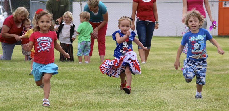 Three children participate in races for special treats, such as popsicles, during the 2014 Kamas Valley Fiesta Days.