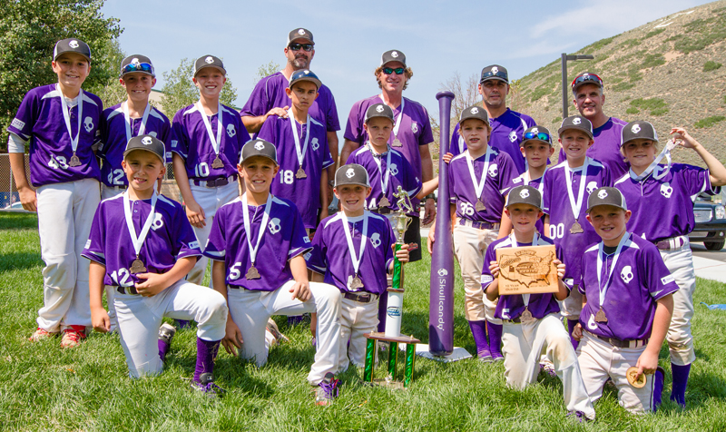 The Skullcandy Crushers 10U squad poses with its Skills Competition trophy and its Triple Crown World Series third-place medals and plaque. (Christopher Reeves/Park Record)