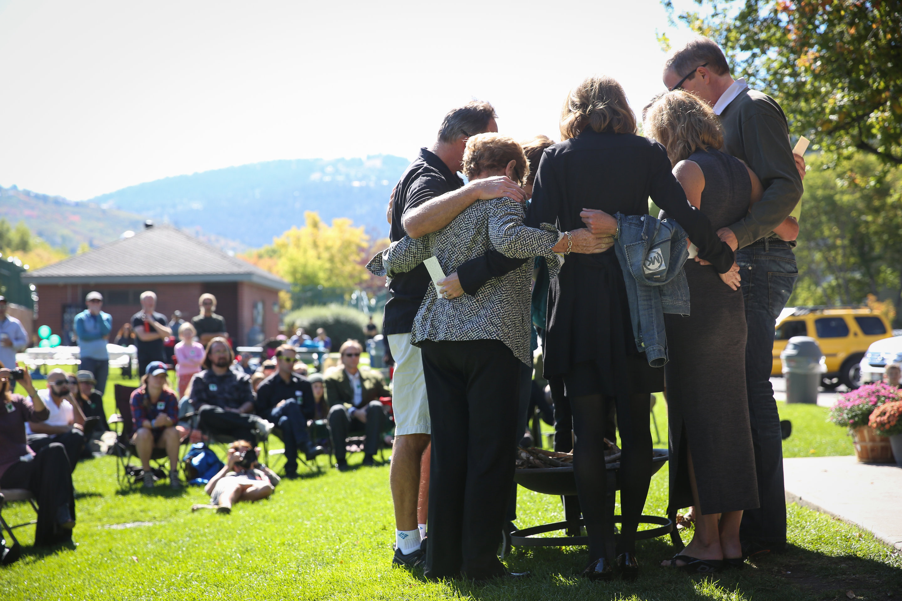 The family of Grant Seaver embraces during a memorial celebrating the 13-year-old boys life Saturday at City Park. Seaver was found dead in his home Sept. 11, and speakers at the memorial say they will miss his loving personality.