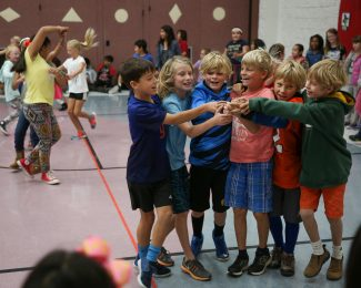 From left Tate Campbell, Van Talbott, Enzo Massimino, Chase Geagan, Graham Winzeler and Henry Peters dance around the McPolin Elementary School gym during the schools celebration of Dia De La Raza.