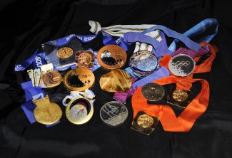 The biggest collection of Olympic gold medals at New York Gold Medal Gala.