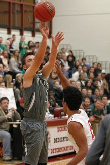 South Summit senior Kaden Atkinson, shown here shooting a three in a game last season, scored 14 points in South Summits 87-63 victory over Tabiona last Tuesday.