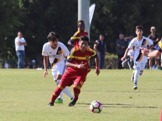 George Pineda, 15, looks to make a pass at the Real Salt Lake Academy Showcase in Los Angeles during the first weekend of November.