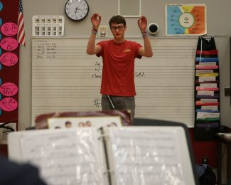 Park City High School's marching band senior drum major Bryan Croce conducts a rehearsal with the woodwinds section Tuesday afternoon, Nov. 29, 2016. The band will be traveling to and performing in Hawai'i on Dec. 7th for the 75th Pearl Harbor commemoration ceremony. (Tanzi Propst/Park Record)