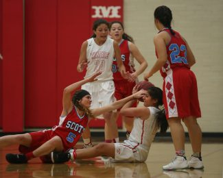 Park City High School's Daneli Pena Arreola (15) rips the ball away from Ben Lommond's Madelynn Neneman (5) during a near jump ball and looks to pass it across the court to a teammate Tuesday evening, Nov. 29, 2016. Arreola is a senior on the team. (Tanzi Propst/Park Record)