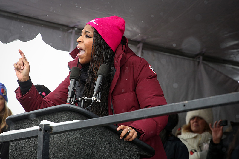American actress and comedian Jessica Williams urges a crowd of more than 5,000 to not lose hope following the March on Main Street Saturday morning, Jan. 21, 2017. Williams was one of a handful of celebrities to speak at the event. (Tanzi Propst/Park Record)
