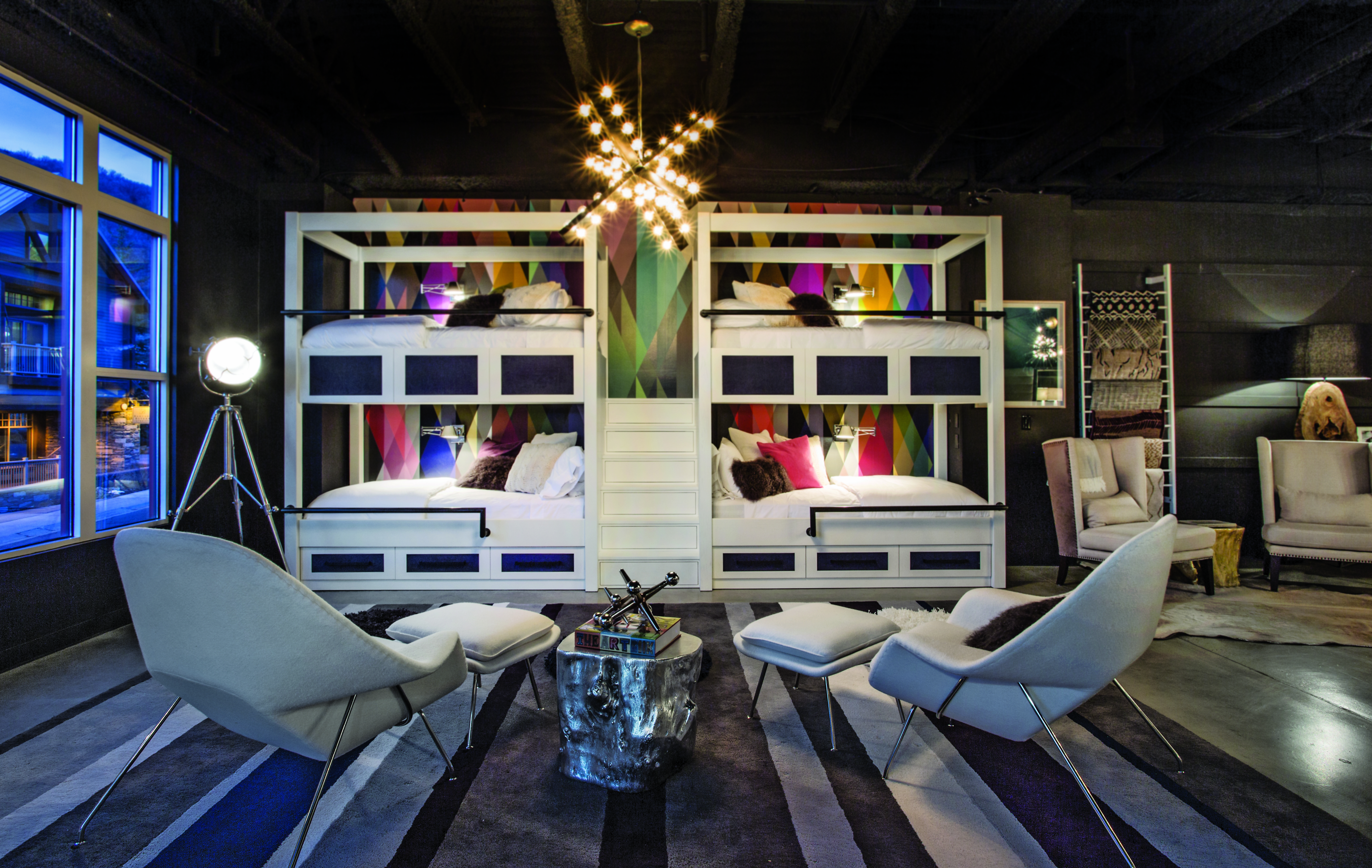 Sleek Modern Chairs A Light Fixture Full Of Bling And Clean White Bunk Bed Lines Result In Chic Bunkroom Designed To Wow Kids Adults Alike