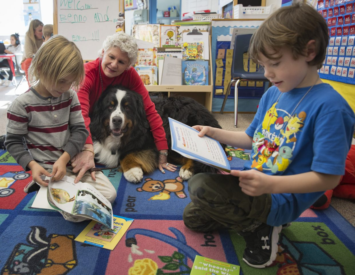 Stryder Marzka, left, and Henry Metcalfe, right, read books to Benno, a five-year-old Bernese Mountain therapy dog, during class time at Trailside Elementary on Thursday, November 30, 2017. Benno and his owner Ellen Folke, both with Intermountain Therapy Animals, visited the class to help the students practice their reading skills. (Tanzi Propst/Park Record)