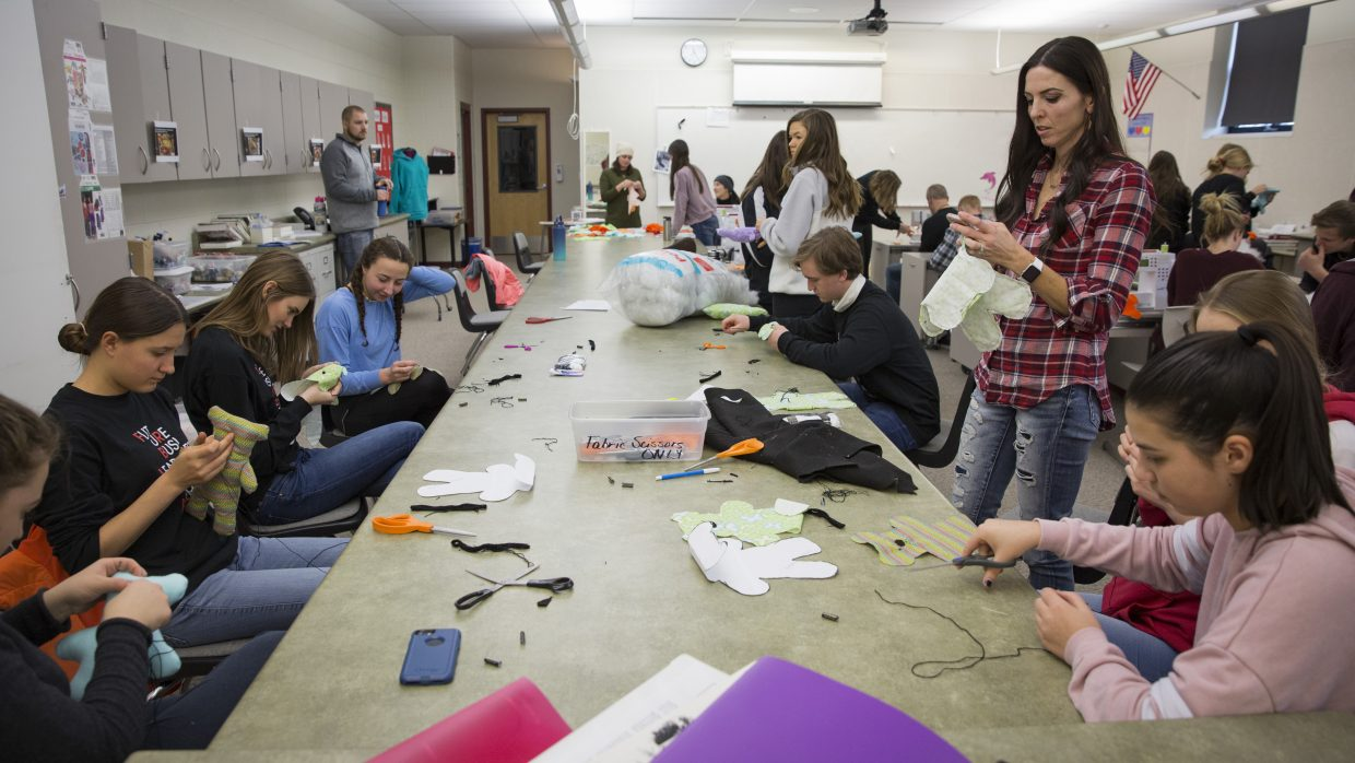 The Future Business Leaders of America group hosts a service activity at Park City High School on Saturday, January 13, 2018. The activity, Dolls of Hope, gave students an opportunity to craft teddy bears for refugee children. (Tanzi Propst/Park Record)