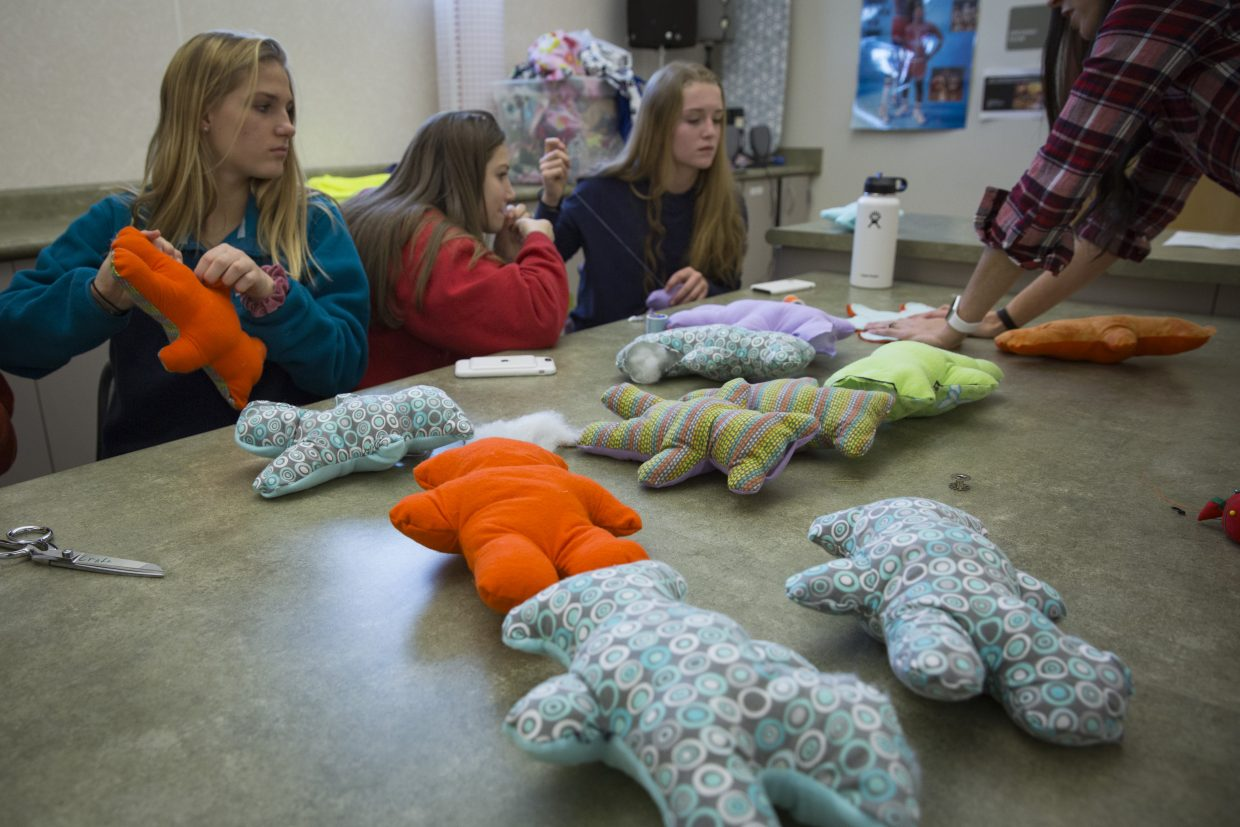Stuffed Dolls of Hope teddy bears wait to have the finishing stitches sewn in during the Future Business Leaders of America service event at Park City High School on Saturday, January 13, 2018. The dolls, once stitched, stuffed and sewn, will be sent to refugee children. (Tanzi Propst/Park Record)