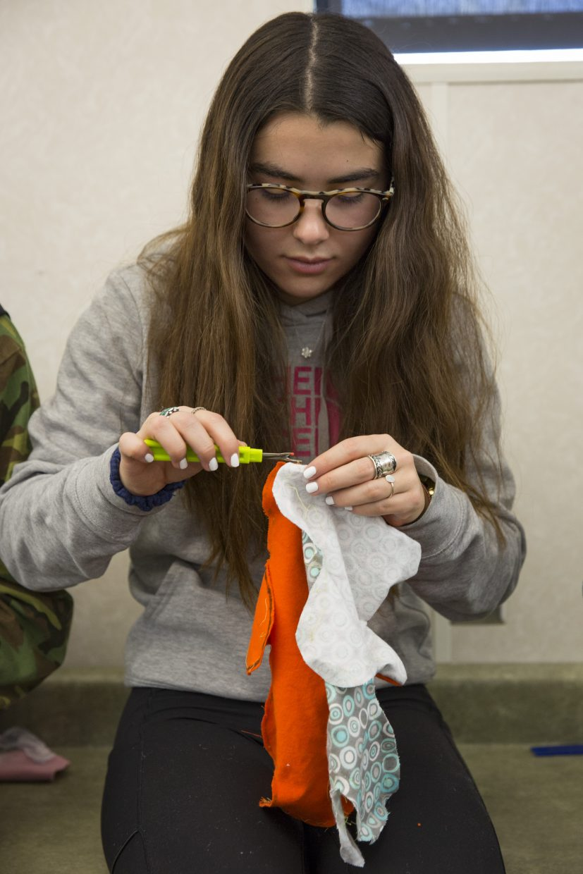 Sofi Gonzalez, a Park City High School senior, works on a Dolls of Hope teddy bear during the Future Business Leaders of America service event on Saturday, January 13, 2018. The dolls, once stitched, stuffed and sewn, will be sent to refugee children. (Tanzi Propst/Park Record)