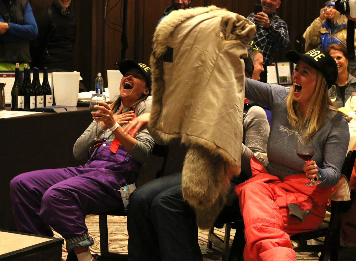Judges laugh while trying to decide who has the best retro ski outfit during the Wine on the Mountain event on March 2, 2018. The event was part of the National Ability Center's annual fundraising efforts during Red, White and Snow. (Kira Hoffelmeyer/Park Record)