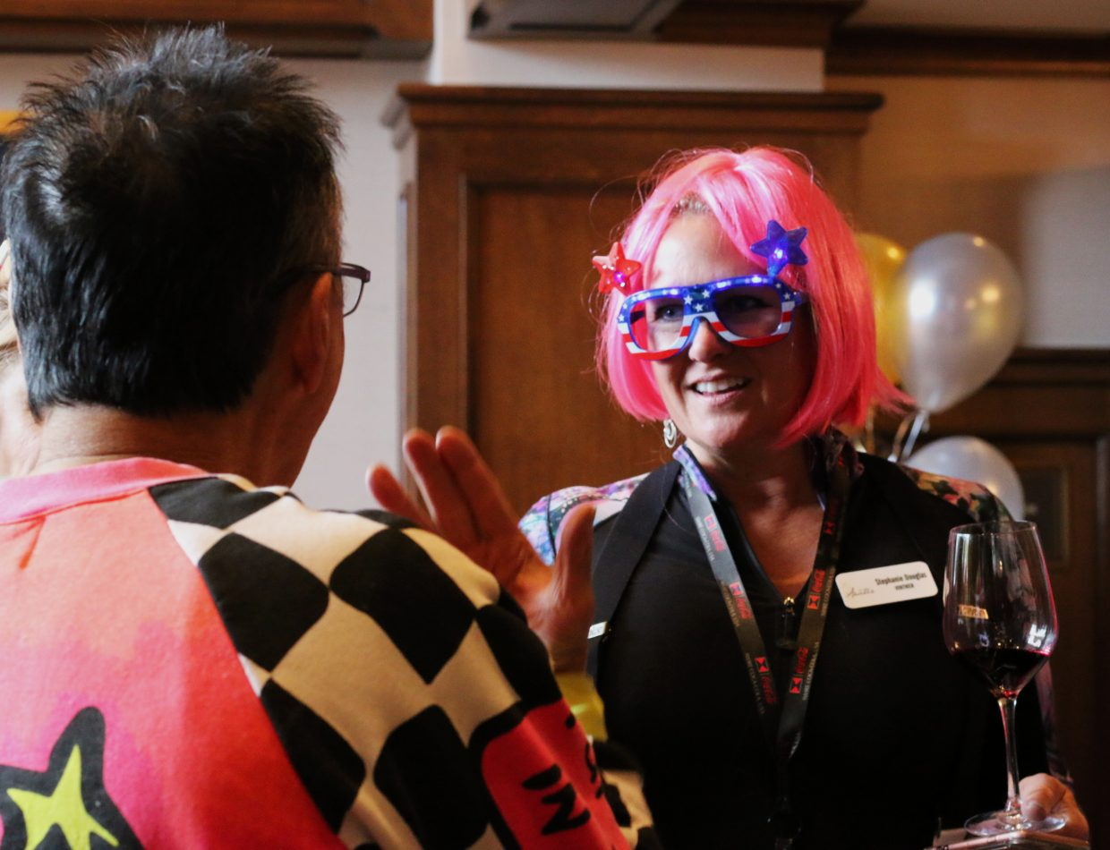 Aratás viniter Stephanie Douglas talks with a fellow attendee of the Wine on the Mountain event at the St. Regis Deer Valley on March 2, 2018. The event is part of the National Ability Center's annual fundraiser, Red, White and Snow. (Kira Hoffelmeyer/Park Record)