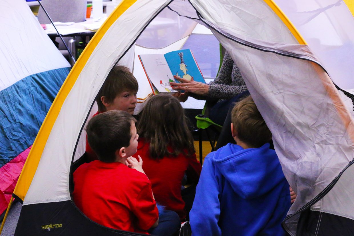 Second grade students at Parley's Park Elementary School gather around volunteers to read Dr. Seuss groups to celebrate the renown author's birthday and Read Across America. on March 2, 2018 (Kira Hoffelmeyer/Park Record)