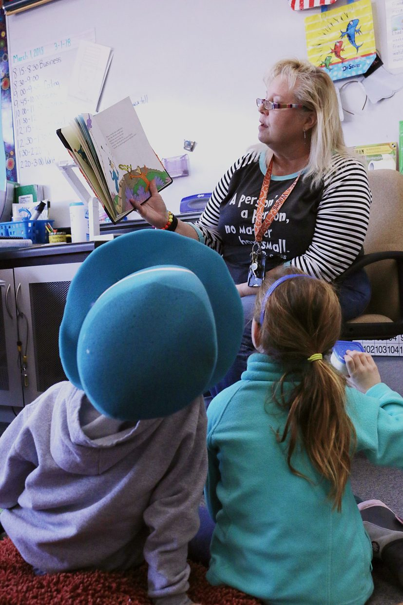 Second grade students Kate Wagner and Micheky Benninga listen to their teacher, Kara Wales, as she reads them a Dr. Seuss book. Parley's Park Elementary School had volunteers come read to them in honor of Dr. Seuss's birthday and Read Across America Day last Friday. During the event, the Park City Education Foundation donated about 300 books to the four elementary schools in the district who participated in the event, said Jen Billow, associate director of the organization. The books donated were in English, French and Spanish.
