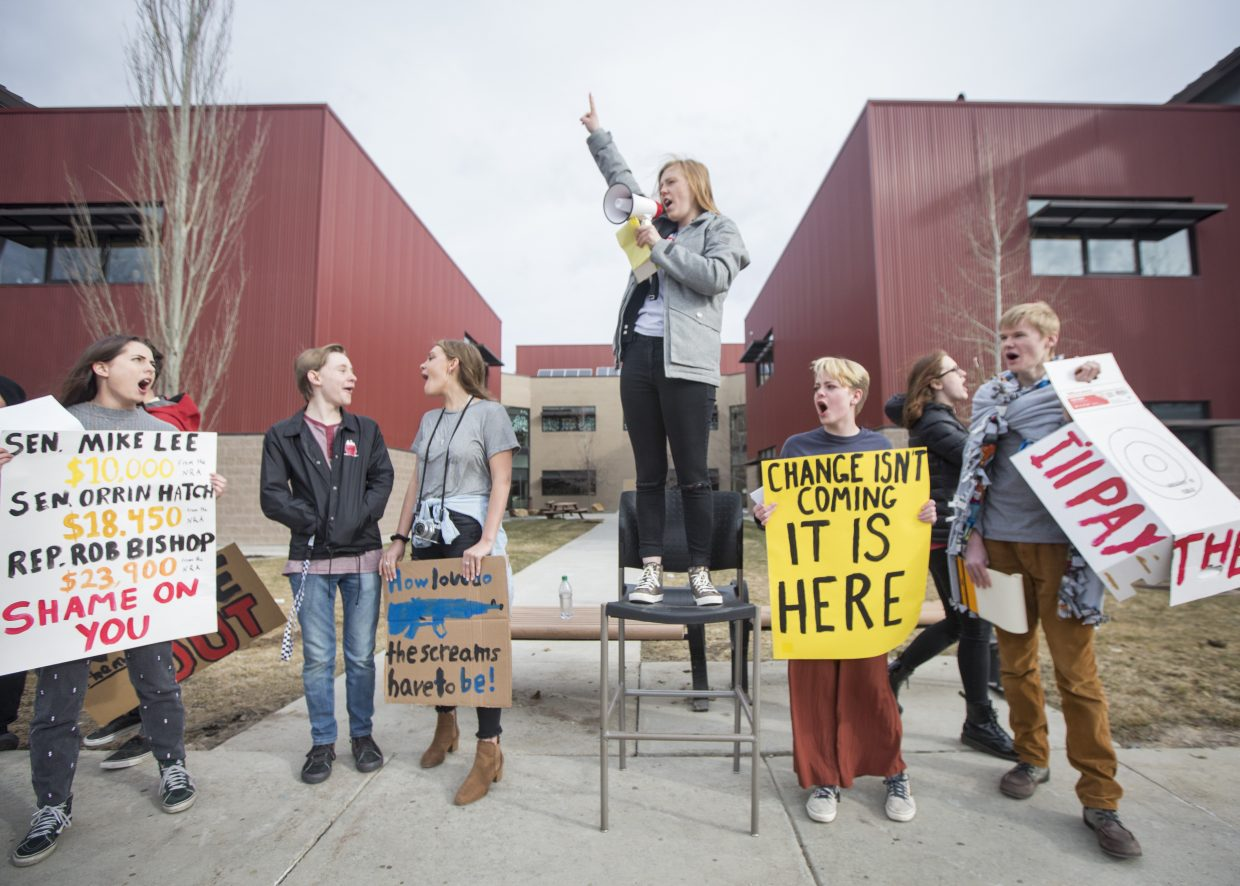 Faith Staley, center, addresses a crowd of Park City High School students during a student walkout Wednesday morning. Staley and other classmates of hers took turns speaking and sharing their frustrations over the current nationwide gun control debate.