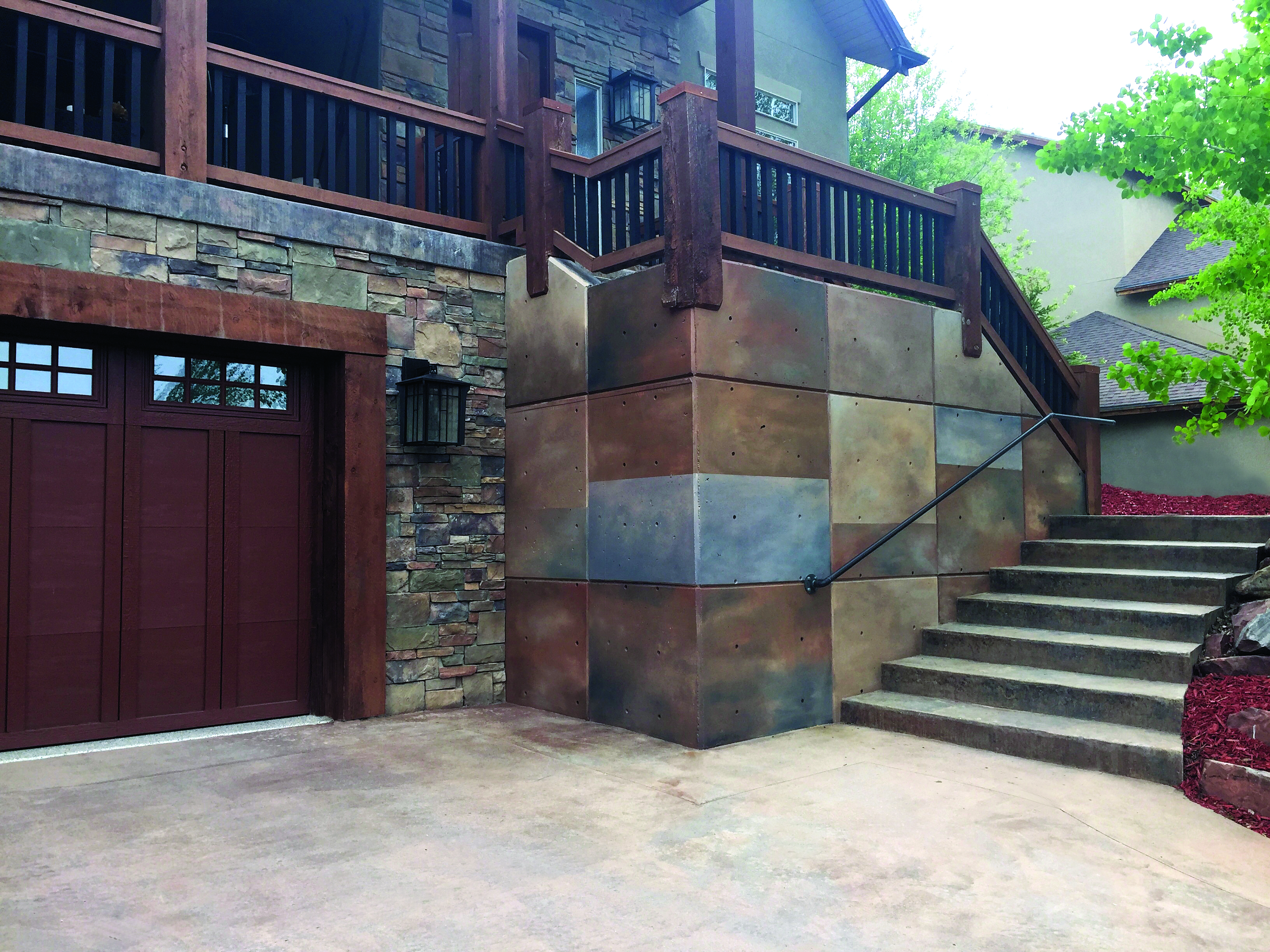 It takes a master faux painter to create the look of real stone on an  exterior wall. The warm and cool tones are a contemporary touch.